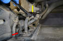 Move to the right upper part of the radiator and remove the quick disconnect for the upper automatic transmission fluid line (red arrow).