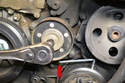 You can also lock the tensioner into the open position if you need both hands to remove or install the belt.