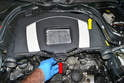 To remove the rear cover/air filter housing grasp it in the center and pull it straight up (red arrow).