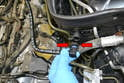 Disconnect the end on the left side of the engine compartment by squeezing in the plastic where it is ridged and then wiggling the connector off (red arrows).