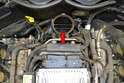 Clean the connecting gasket area around the elbow pipe and check for any cracks in the pipe before installing the new MAF (red arrow).