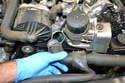 Wiggle and pull the hose from the thermostat and be prepared for some coolant to spill out.