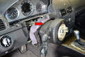 Next, remove the steering column switch module (red arrow) and trim surround.