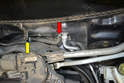 With the wiper motor removed you can see and access the upper supply hose (red arrow).