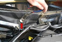 Use a set of long needle nose pliers, and turn the wiper arm mount counter clockwise to remove it (red arrow).
