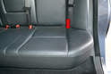 Rear Seat- There is a metal hook on the bottom of the bench that you cannot see but is approximately where the red arrow is on each side.
