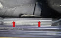 Next, remove the doorsill plate by inserting a trim removal tool under the plate and gently prying it up (red arrows).