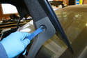 Use your trim removal tool, and remove the push pull pins on each trunk support arm.