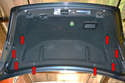Next, remove the eight push/pull pins from the trunk liner (red arrows).