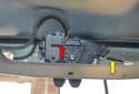 You can now access the latching mechanism under the trunk lid.