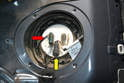 Clean the dust and debris off the top of the pump and unplug the one connection (red arrow).