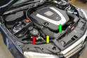 The coolant expansion tank or reservoir is located at the front right side of the engine compartment (red arrow).