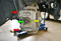 The front brakes on the W204 are of a floating caliper (yellow arrow) design.