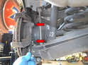 Use a 18mm wrench and remove the two caliper mounting bolts (red arrows).