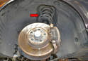 The strut assembly (red arrow) on the W204 connects and controls the up and down movement of the wheel hub.