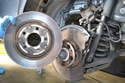 The parking brake pads use the inside of the rear brake rotor to push against so you need to remove the rotor to access them.