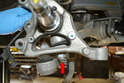 Even though you have removed the tie rod ball joint you may want to leave it loosely in the knuckle while you remove the other nuts.
