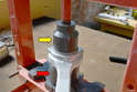 Take the arm to your press and press out the old bearing and press in a new one in.