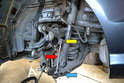 This photo shows the drop link (red arrow) and how it attaches to the sway bar on the top (yellow arrow) and the control arm on the bottom (blue arrow).