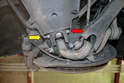 To remove the drop link use an E12 Torx (red arrow) and 13mm wrench (yellow arrow) and remove the lower connecting bolt.