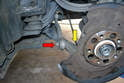 Spin the dust shield and remove the hardware for the tie rod (red and yellow arrows).