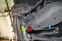 There are two nuts and bolts sticking out from the end of the swing control arm, DO NOT remove these, they are for the wheel carrier (yellow arrow) and the sway bar drop link (red arrow).