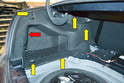 Open the trunk, remove the lower carpet and then remove the fasteners on the side panels.