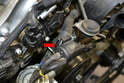 Release the tab on the rear of the valve and slide it off the mount (red arrow).