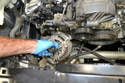 With a little wiggling and work you can remove the alternator from the engine.