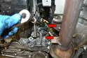 The starter motor is held in place by two E14 Torx bolts that are mounted from the bellhousing side.