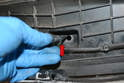 Use a small flathead screwdriver and gently pry the sensor out from the plastic hole it sits in.