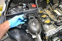 Once the system has cooled to below 40 C slowly open the coolant reservoir cap to release the pressure in the system.
