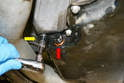 If you do not want to install the drain plug and washer at this point at the very least install the old one (red arrow) to prevent accidental spilling of oil out of the plug while you are removing the bolts (yellow arrow) and pan.