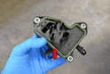 If you have removed the separator for any other reason than replacement and are reinstalling it make sure to replace the gasket (red arrow).