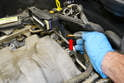 Pull the EGR hose from the top of the throttle body (red arrow) and move the hose out of the way.