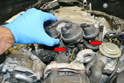 Lift up the front of the intake and separate the two lines going into the manifold (red arrows).