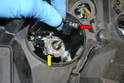 Open the port for the headlight and remove the electrical connection from the bulb by pulling it straight off (red arrow).