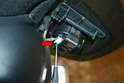 Use a small flathead screwdriver and release the plastic tab (red arrow) and pull the wiring connection from the sensor.