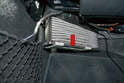 With the clip forward you can simply pull the air filter down and out from the housing (red arrow).
