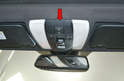 You are going to be gently prying out the upper console from the headliner (red arrow).