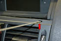 Center Vents - Insert your tool into the access holes and turn them 90 degrees so they are facing downward (red arrow).