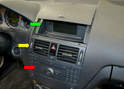 There are three components in the center of the dash: the control monitor (green arrow), the center vents (yellow arrow) and the stereo unit (red arrow).