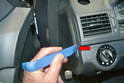 If you are replacing the cable in the cabin begin by removing the trim piece on the end of the dash.