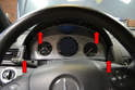 Use a long handled T20 Torx and remove the four Torx screws (red arrows) holding the cluster in the dash.