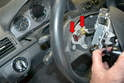 With both screws fully loosened (they will stay in the wheel) pull the airbag away from the wheel.