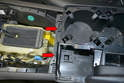 Use the T20 Torx and remove the two screws on the front of the console (red arrows).