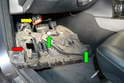 Dropping the panel further down you can separate the two other wiring connections (green arrows) and push the handle for the hood release (yellow arrow) up and out of the port in the panel (red arrow).