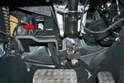 The switch is located up under the dash (red arrow) just in front of the brake pedal.