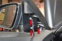 Use a T25 Torx and remove the three screws holding the mirror to the door (red arrows).