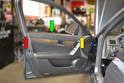 When removing the door panel begin by placing the window in the lowest position it will go (green arrow).